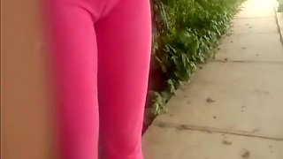 Filming cameltoe of chick in pink yoga pants