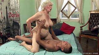 Horny granny Norma gets her ruined snatch hammered well