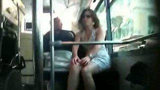 Woman teases with her legs in a bus in hidden cam video