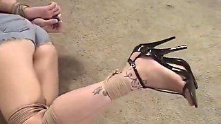 girl in glasses tied up