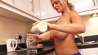 Naughty blonde pours milk all over her tits in the kitchen