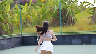 Sassy Asian girl Yuka Hirata plays tennis on the court