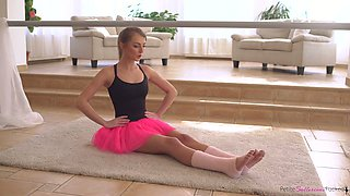 Lovely slender dancer in cute tutu Katy Rose is poked in standing pose