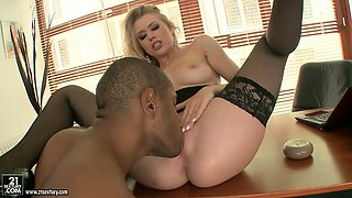Arousing blonde secretary with long hair eats big black dick at the office