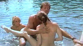 Nikki Charm joins her kinky friends for a shag in a swimming pool